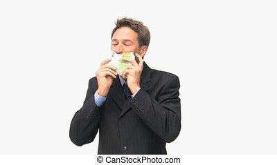 Businessman kissing euro notes