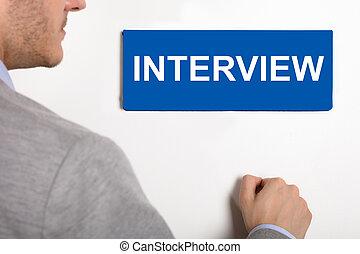 Businessman Knocking Door With Interview Nameplate