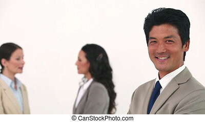 Businessman laughing in front of his colleagues -...