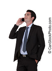 Businessman laughing on the phone