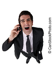 Businessman laughing out loud during call