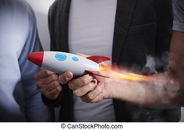 Businessman launches his startup company with a rocket