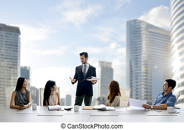 Businessman leading a meeting with team of colleagues