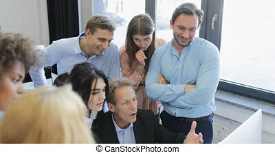 Businessman Leading Team Meeting Present New Idea On Computer With Group Of Business People Discussing Project In Modern Office