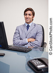 Businessman leaning back satisfied