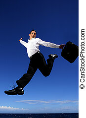 Businessman leaping through the air
