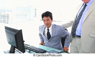 Businessman letting his seat to his boss