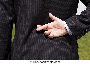 Businessman lie - a businessman telling a lie with the...