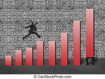 Businessman lift one red bar and another jumping on chart