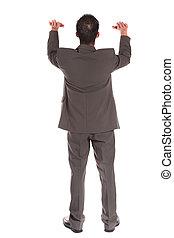Businessman lifting his arms