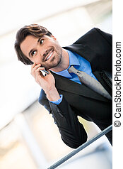Businessman listening to a call on his mobile