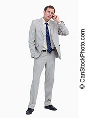 Businessman listening to caller against a white background