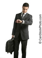 Businessman look his watch with handbag