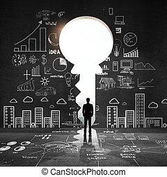 big key and drawing concept - businessman looking an big key...