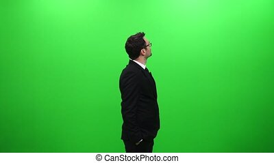 Businessman Looking Around Against A Green Screen