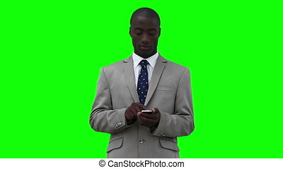 Businessman looking around him as he dials on his phone