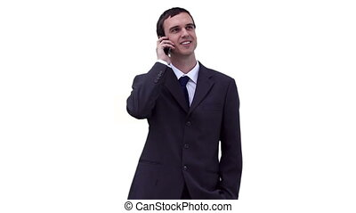 Businessman looking around while making a call