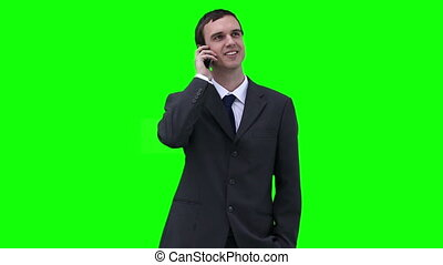 Businessman looking around while talking on a phone