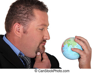 Businessman looking at a globe