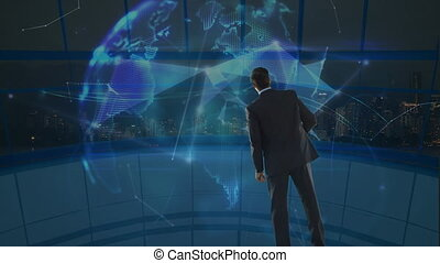 Businessman looking at a spinning earth globe surrounded by data connections