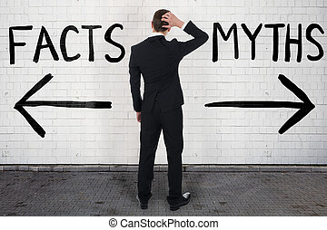 Businessman Looking At Arrow Signs Below Facts And Myths -...