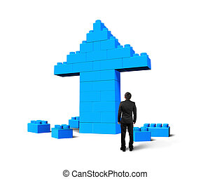 Businessman looking at arrow up shape of stack blocks