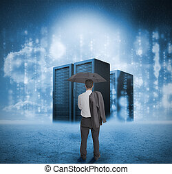 Businessman looking at blue servers