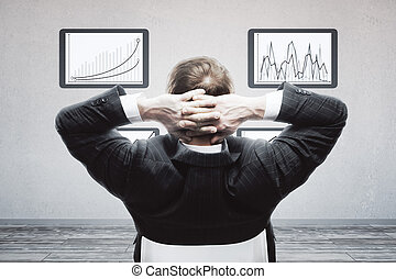 Businessman looking at business charts