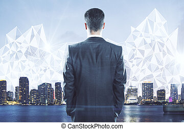 Businessman looking at city with polygonal pattern