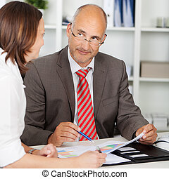 businessman looking at colleague in meeting