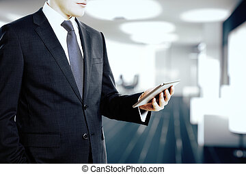 Businessman looking at digital tablet in the office