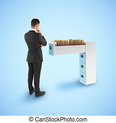 businessman looking at file cabine