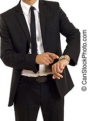 businessman looking at his watch - businessman looking and...