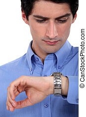 Businessman looking at his watch.