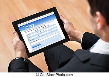 Businessman Looking At Online Survey Form