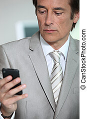 Businessman looking at phone