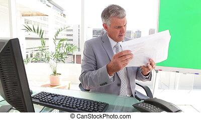 Businessman looking at sheets