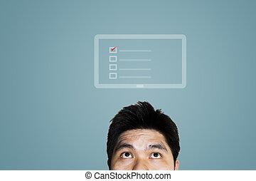 Businessman looking at tablet symbol