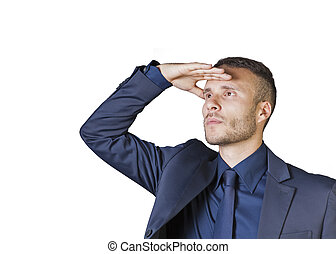 a young businessman with hand to forehead to scan the horizon