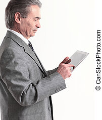 businessman looking at the screen tablet.isolated on white background