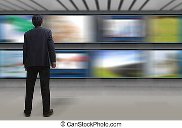 Businessman looking at the TV screen