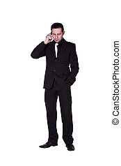 Businessman looking down while talking on the phone -...