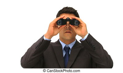 Businessman looking for someone with a pair of binoculars
