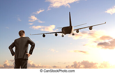 businessman looking on airplane
