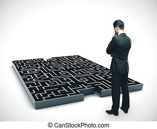 Businessman looking on black labirinth. Success and startup concept.