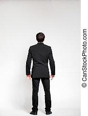 Businessman looking on empty wall