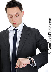Businessman looking on his watch