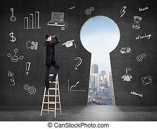 businessman looking on keyhole - businessman standing on...