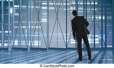 Businessman looking outside of empty office