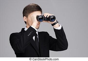 Businessman Looking Through a Binoc
